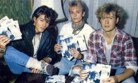 a-ha with copies of the first release of Take On Me